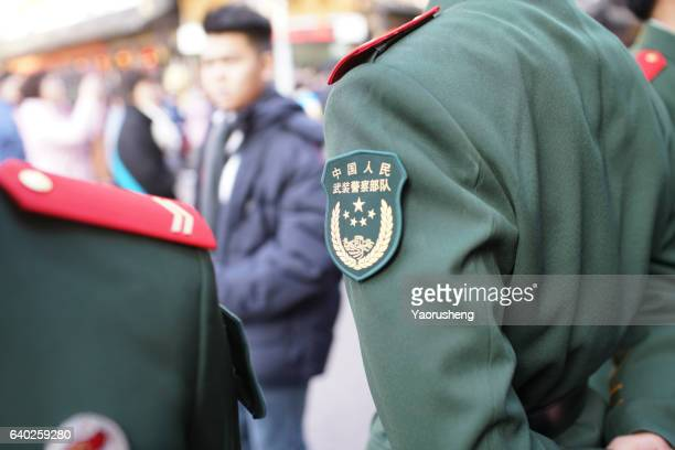 Chinese soldiers in change of guard marching at Yu Garden duiring Chinese new year
