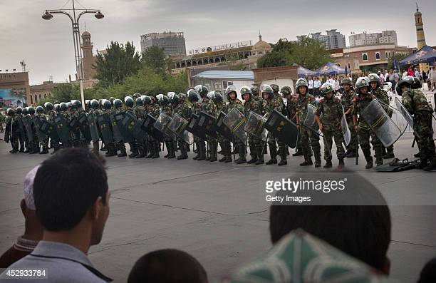 Chinese soldiers in riot gear stand outside the Id Kah Mosque China's largest on July 31 2014 in Kashgar China China has increased security in many...