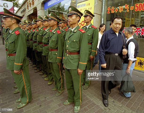 Chinese soldiers line up on a street October 20 2001 in Shanghai Police and soldiers monitored streets and public areas as world leaders met at the...
