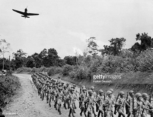 Chinese soldiers march down a road in North Burma on their way to engage in battle with Japanese forces in the Naga hills These soldiers were trained...