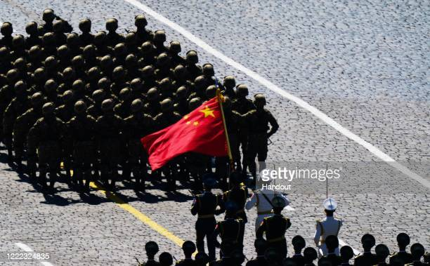 Chinese soldiers march during the Victory Day military parade in Red Square marking the 75th anniversary of the victory in World War II, on June 24,...