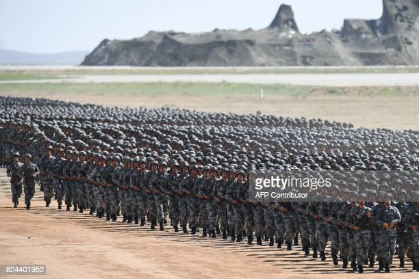 TOPSHOT Chinese soldiers march in a military parade at the Zhurihe training base in China's northern Inner Mongolia region on July 30 2017 China held...