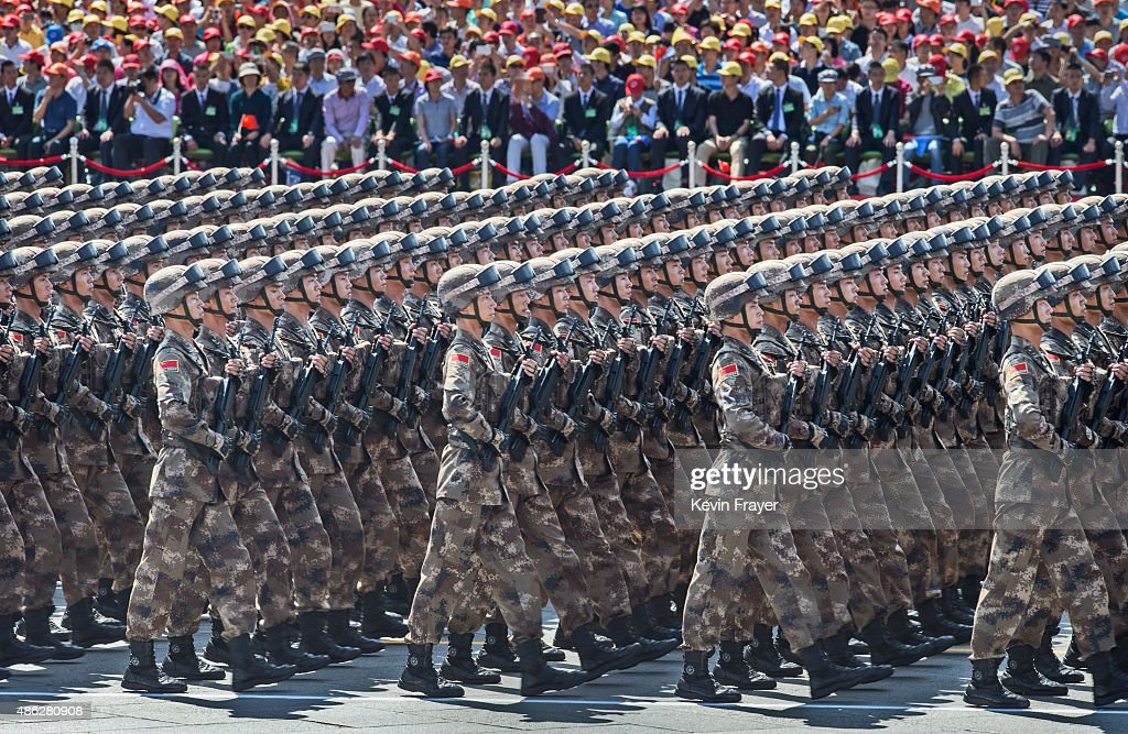Chinese soldiers march in formation passed Tiananmen Square and the Forbidden City during a military parade on September 3, 2015 in Beijing, China. China is marking the 70th anniversary of the end of World War II and its role in defeating Japan with a new national holiday and a military parade in Beijing.