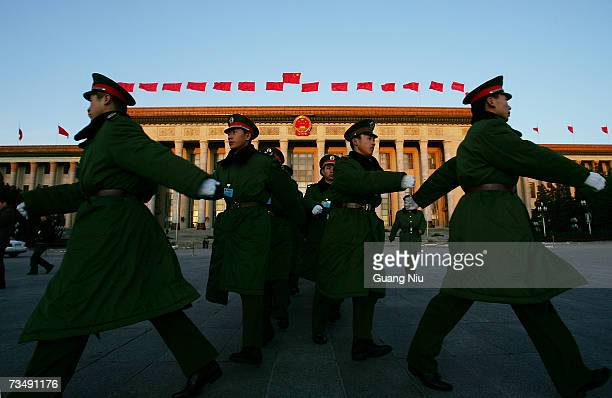 Chinese soldiers march in front of the Great Hall of the People before the opening session of the National People's Congress or parliament on March 5...