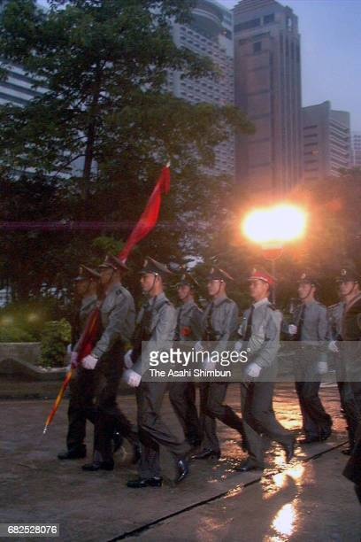 Chinese soldiers march on at the former British Armed Force headquarters after the handover on July 1 1997 in Hong Kong