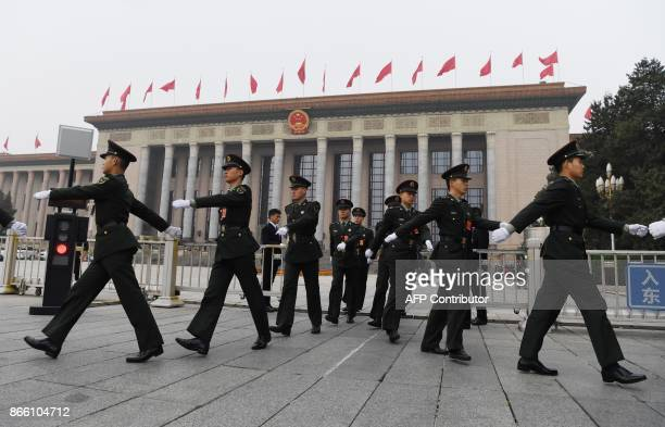 Chinese soldiers march outside the Great Hall of the People in Beijing, before the introduction of the Communist Party of China's Politburo Standing...