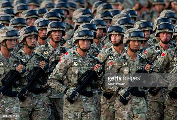 Chinese soldiers march past Tiananmen Square before a military parade on September 3, 2015 in Beijing, China. China is marking the 70th anniversary...