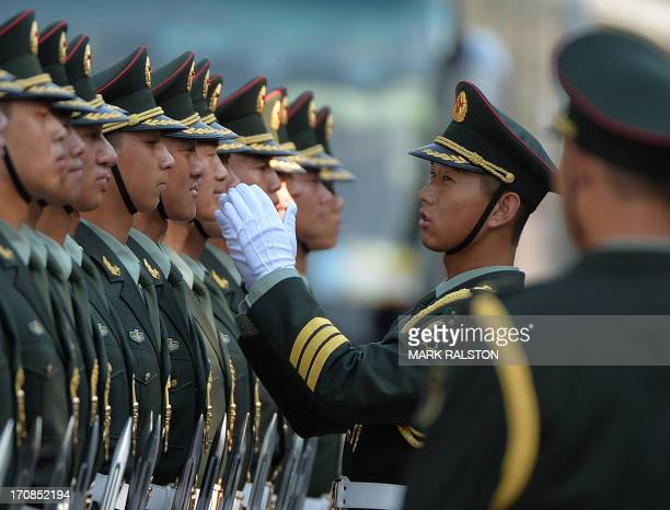 Chinese soldiers march past unseen Chinese President Xi Jinping and his Vietnamese counterpart Truong Tan Sang during the welcoming ceremony at the...