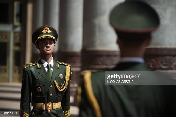 Chinese soldiers prepare for a welcome ceremony for Cambodia's Prime Minister Hun Sen outside the Great Hall of the People in Beijing on May 16 2017...