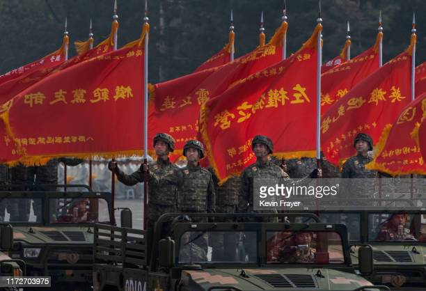 Chinese soldiers ride in jeeps as they drive in a parade to celebrate the 70th Anniversary of the founding of the People's Republic of China in 1949...