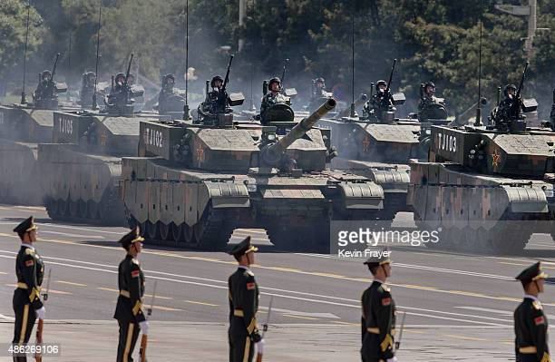 Chinese soldiers ride in tanks as they make their way towards Tiananmen Square and the Forbidden City during a military parade on September 3 2015 in...