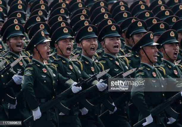 Chinese soldiers shout as they march in formation during a parade to celebrate the 70th Anniversary of the founding of the People's Republic of China...