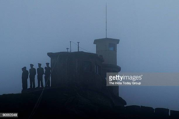 Chinese soldiers stand at a Chinese post on the Chinese side of the border at Nathu La Trade between India and China is set to begin on July 6th 2006...