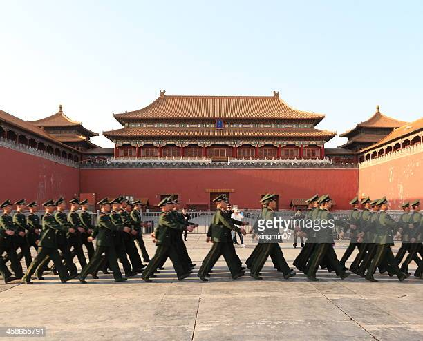 chinese soldiers through the forbidden city - communism stock pictures, royalty-free photos & images