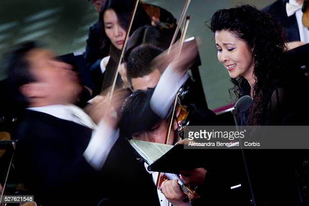 Chinese soprano Lan Rao performs during a special concert performed by the China Philharmonic Orchestra and directed by chinese director Long Yu in...