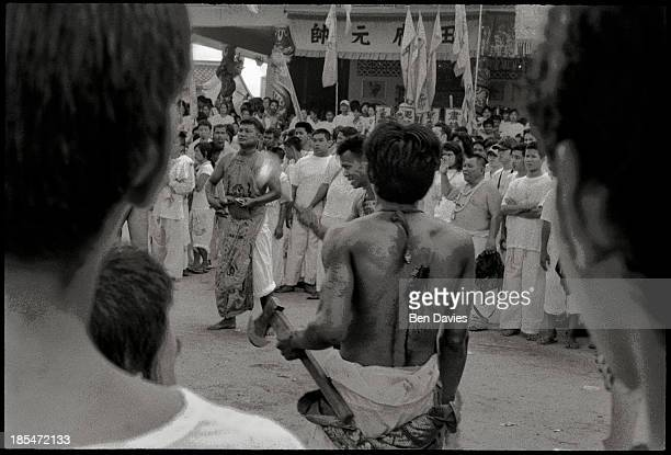 Chinese spirit mediums perform spectacular feats of selfmutilation during the vegetarian festival on the island of Phuket in Southern Thailand Having...