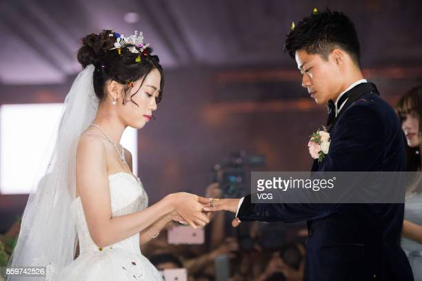 Chinese sprinter Su Bingtian and wife Lin Yanfang hold their wedding ceremony on October 10 2017 in Zhongshan Guangdong Province of China