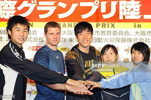 Chinese star hurdler Liu Xiang poses with other athletes US Polevaulter Brad Walker Japanese 400m hurdler Kenji Narisako Kumiko Ikeda in the longjump...