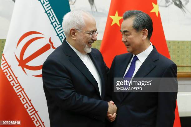 Chinese State Councillor and Foreign Minister Wang Yi meets Iran's Foreign Minister Mohammad Javad Zarif at the Diaoyutai state guesthouse in Beijing...