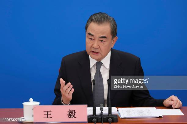 Chinese State Councilor and Foreign Minister Wang Yi attends a press conference of the third session of the 13th National People's Congress at the...