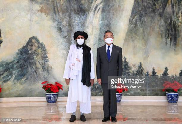 Chinese State Councilor and Foreign Minister Wang Yi meets with Mullah Abdul Ghani Baradar, political chief of Afghanistan's Taliban, in north...