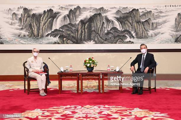 Chinese State Councilor and Foreign Minister Wang Yi R meets with U.S. Deputy Secretary of State Wendy Sherman in north China's Tianjin on July 26,...