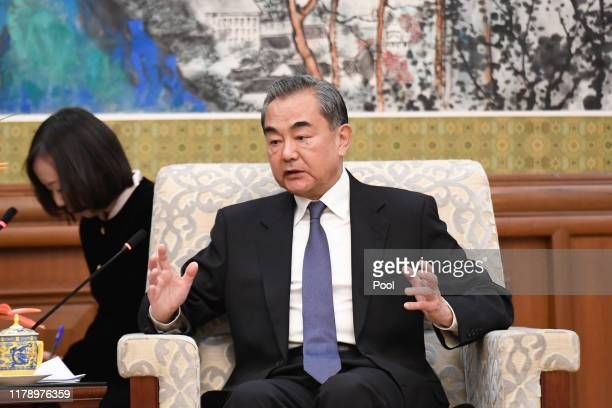 Chinese State Councilor and Foreign Minister Wang Yi speaks during a meeting with former Ethiopian President Mulatu Teshome at the Diaoyutai State...