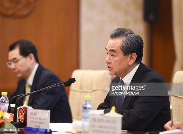 Chinese State Councilor and Foreign Minister Wang Yi speaks to Pakistan's Foreign Minister Khawaja Muhammad Asif during their meeting at the...