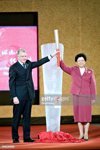Chinese State Councilor Chen Zhili right and International Olympic Committee Coordination Commission Chairman Hein Verbruggen unveil the Olympic...
