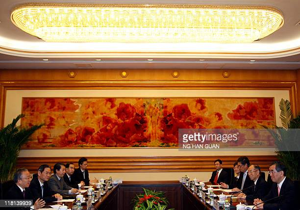 Chinese State Councilor Dai Bingguo speaks with Japan's foreign minister Takeaki Matsumoto at the Zhongnanhai leaders compound in Beijing on July 4...
