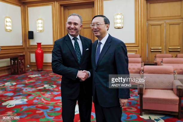 Chinese State Councilor Yang Jiechi and Mark Sedwill national security advisor to the British prime minister pose for photograph during a meeting at...