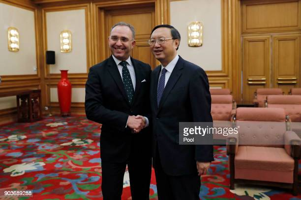 Chinese State Councilor Yang Jiechi right and Mark Sedwill national security advisor to the British Prime Minister pose for photograph before their...