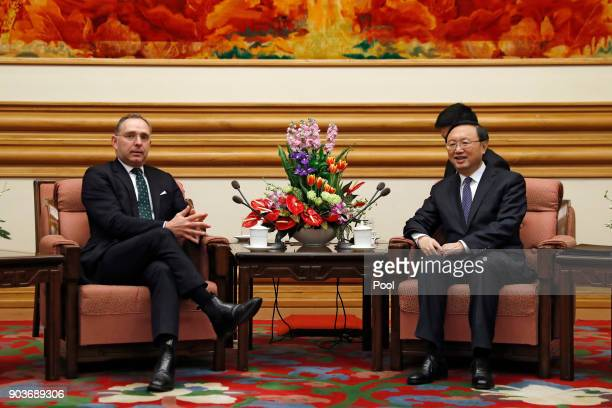 Chinese State Councilor Yang Jiechi right chats with Mark Sedwill national security advisor to the British Prime Minister during a meeting at the...