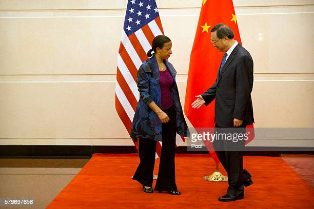 Chinese State Councilor Yang Jiechi right reaches to shake hands with US National Security Adviser Susan Rice left as she arrives for a meeting at...