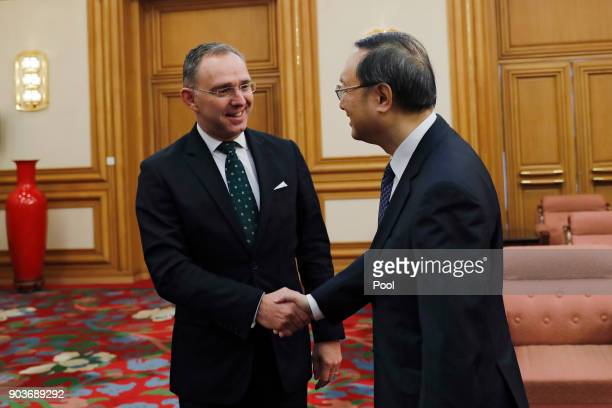 Chinese State Councilor Yang Jiechi right shakes hands with Mark Sedwill national security advisor to the British Prime Minister at the Zhongnanhai...