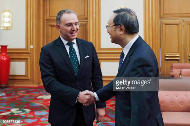 Chinese State Councilor Yang Jiechi shakes hands with Mark Sedwill national security advisor to the British prime minister during a meeting at the...