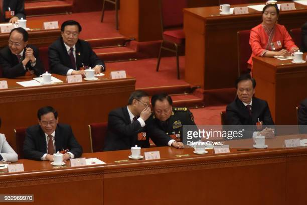 Chinese State Councilor Yang Jiechi speaks with China's Central Military Commission Vice Chairman Zhang Youxia during the 5th plenary session of the...