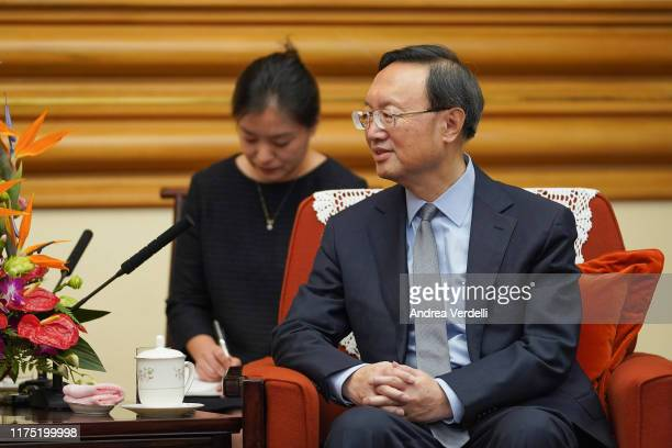 Chinese State Councilor Yang Jiechi talks to President of the International Olympic Committee Thomas Bach at Zhongnanhai on September 17, 2019 in...