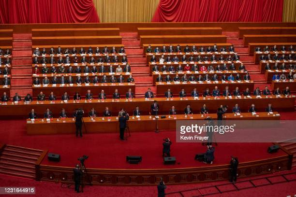 Chinese state media take photos and film China's President Xi Jinping, center, and other senior leaders and lawmakers during the closing session of...