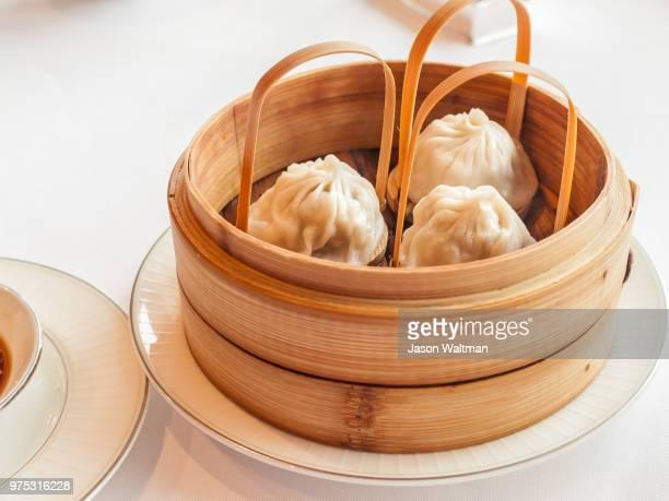 Chinese steamed dumplings Xiaolongbao in bamboo basket, Hong Kong