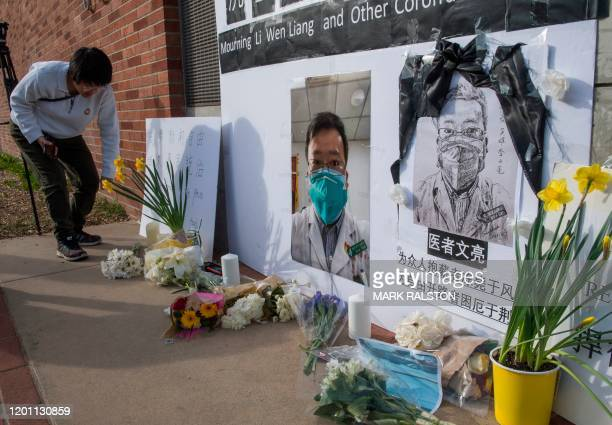 Chinese students and their supporters hold a memorial for Dr Li Wenliang who was the whistleblower of the Coronavirus Covid19 that originated in...