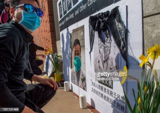 Chinese students and their supporters hold a memorial for Dr Li Wenliang, who was the whistleblower of the Coronavirus, Covid-19, that originated in...