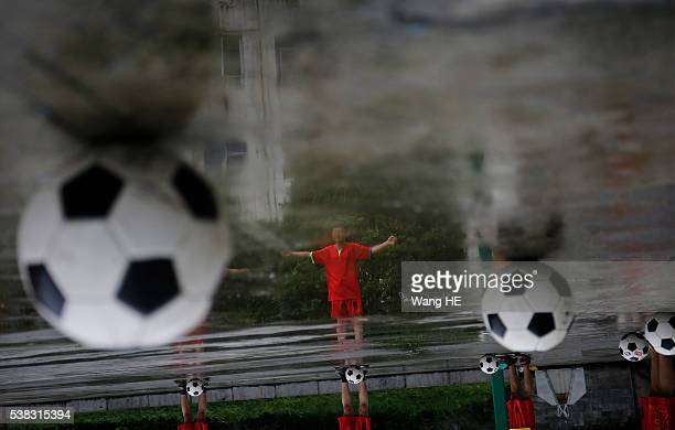 Chinese students are seen during a football training session in the campus of the Yuyang Middle School in Wufeng Tujia Nationality Autonomous County...