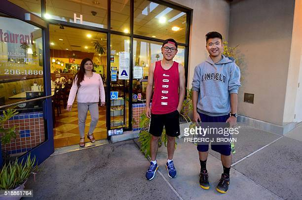 Chinese students Karl Li from Jiangsu and Wisdom Xiewei from Chongqing are joined by their Host family mother Zennie Relova following a Vietnamese...