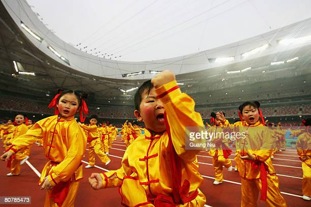 """Chinese students perform traditional martial arts ahead of the """"Good Luck Beijing"""" 2008 Marathon Competition at the National Stadium, or the """"Bird's..."""