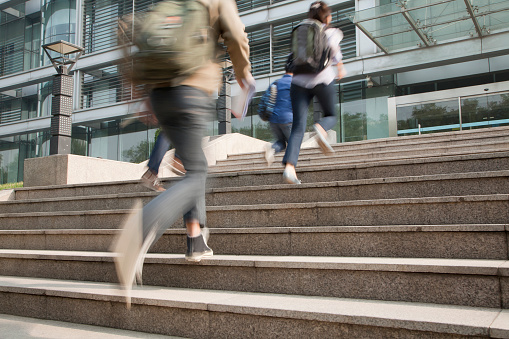 Chinese students running on campus 1083161184