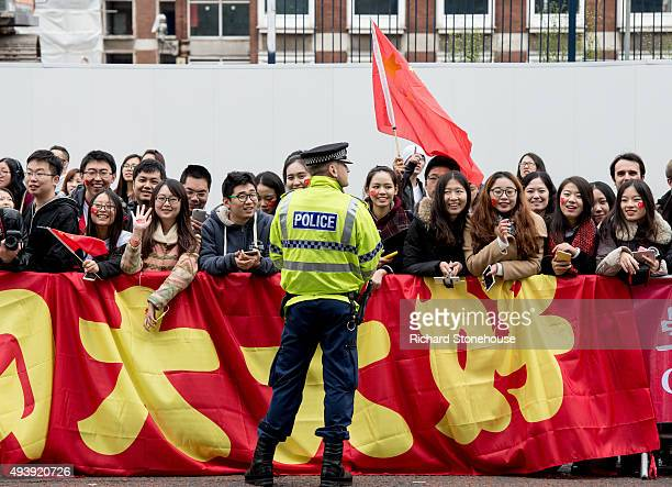 Chinese students show support for the President of the People's Republic of China Xi Jinping as he arrives to tour the National Graphene Institute at...