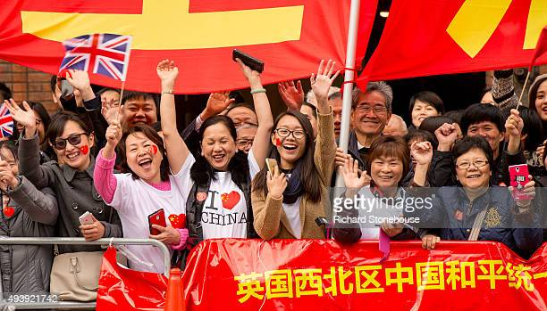 Chinese students show support for the President of the People's Republic of China Xi Jinping as he arrives at Manchester Town Hall on October 23 2015...
