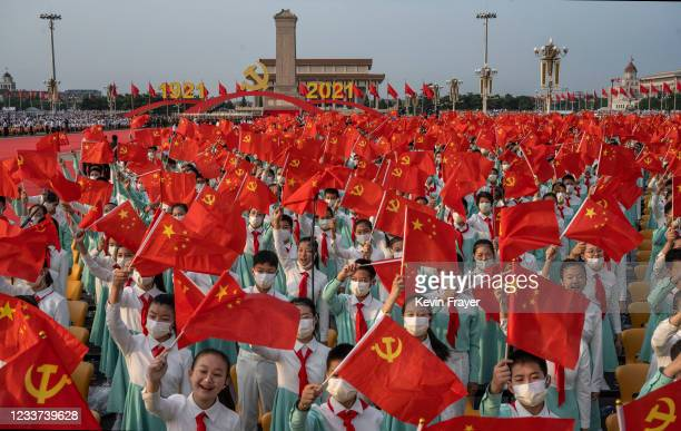 Chinese students who were to sing as a choir wave party and national flags at a ceremony marking the 100th anniversary of the Communist Party on July...