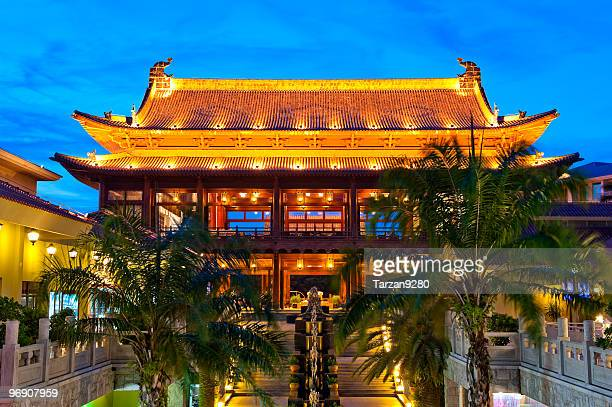 chinese style building after sunset - sanya stock pictures, royalty-free photos & images